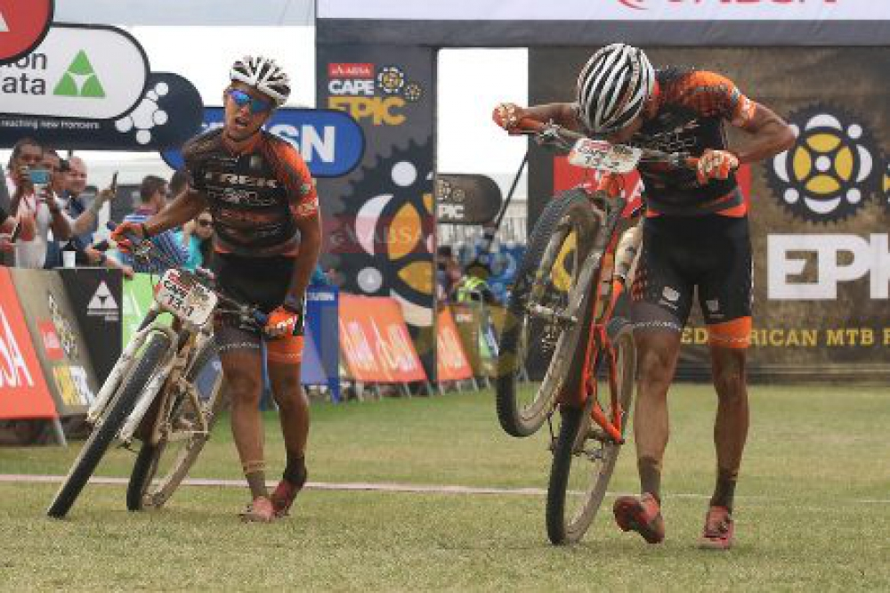 Damiano Ferraro of Trek-Selle San Marco A (Right) kisses his number board after winning stage 4 with partner Samuele Porro of Trek-Selle San Marco A during stage 4 of the 2016 Absa Cape Epic Mountain Bike stage race from the Cape Peninsula University of Technology in Wellington, South Africa on the 17th March 2016 Photo by Shaun Roy/Cape Epic/SPORTZPICS PLEASE ENSURE THE APPROPRIATE CREDIT IS GIVEN TO THE PHOTOGRAPHER AND SPORTZPICS ALONG WITH THE ABSA CAPE EPIC {ace2016}